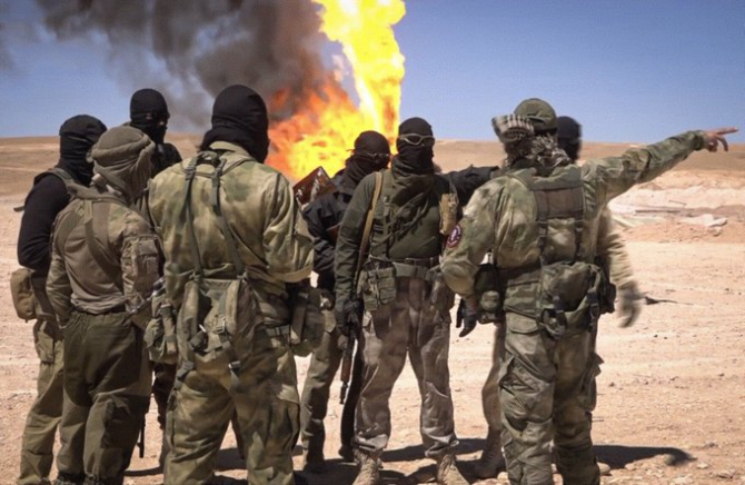 Mercenari ai companiei militare private ruse (PMC) Wagner Group.