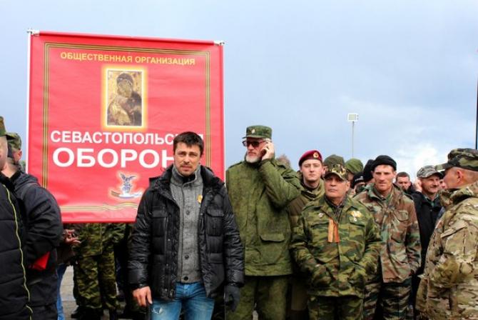 Alexandr Franchetti - centru - a fost reținut pe aeroportul internațional din Praga pe 12 septembrie, este căutat de Ucraina pentru că a coordonat operațiunea paramilitară de anexare a Crimeei la Rusia în 2014.